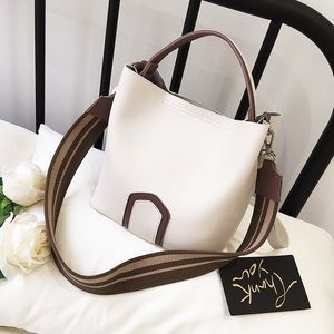 White and brown leather wide strap crossbody bag